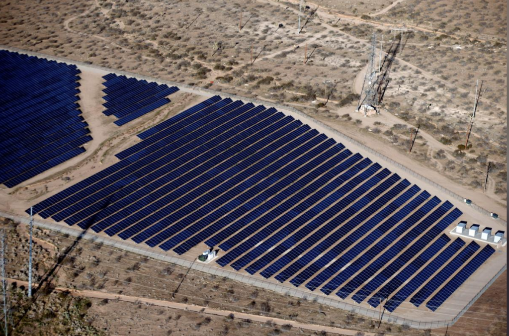 FILE PHOTO: An array of solar panels is seen in the desert in Victorville, California March 13, 2015. REUTERS/Lucy Nicholson/File Photo